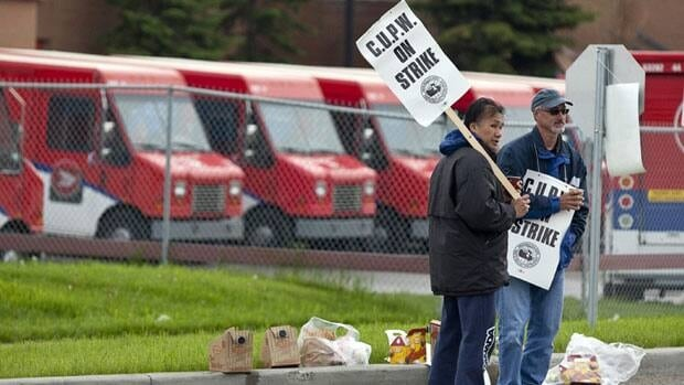 Postal workers took part in a 24-hour strike in Calgary in 2011. The Canadian Union of Postal Workers is in a strike position starting July 2.