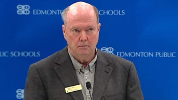 Dave Colburn, chairman of the Edmonton Public Schools' board of trustees, listens to a reporter's question at a news conference Tuesday.