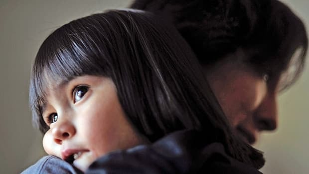 Mireya Salazar rests her head on aunt Melinda's shoulder at the Salazar home in Denver in March. Mireya has autism, which a new study estimates affects about 2.6 per cent of the population compared with the current U.S. estimate of 1 per cent.
