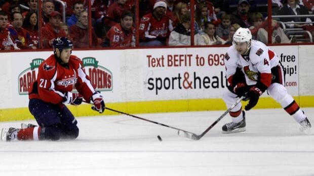 Brooks Laich, left, of the Capitals and Chris Phillips of the Senators compete for the puck at the Verizon Center back on Dec. 3.