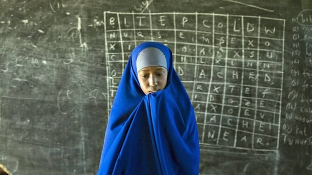 A Somali girl at a school inside the Hagadera refugee camp in Dadaab in northeastern Kenya in 2009. In the 1990s, elders in the Dadaab refugee compound, which includes Hagadera, pushed aid organizations to set up schools in the camp. Today, refugee children can earn Kenyan high school diploma within the camp school system but have few prospects beyond graduation.