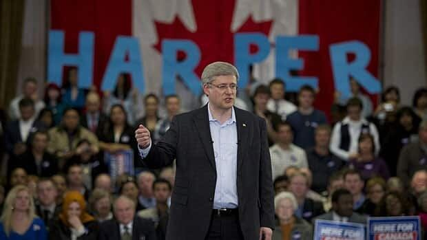 Stephen Harper delivers a speech during a campaign rally in Ajax, Ont., April 6. A Toronto Conservative candidate is distancing himself from a staffer's email calling for supporters to dress in 'ethnic costume' outfits for a Harper rally in Etobicoke Thursday. Sean Kilpatrick/Canadian Press