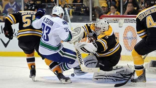 Boston goalie Tim Thomas produced one of the more memorable moments of Game 3 when he levelled Vancouver star Henrik Sedin in front of the Bruins' net.