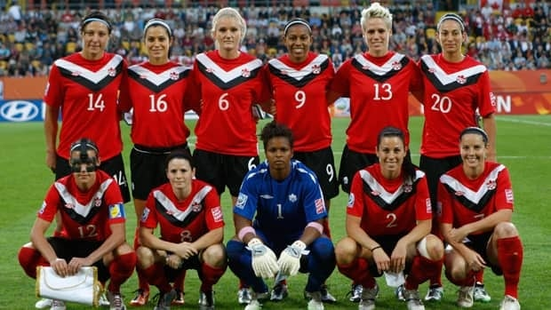 Canada's Melissa Tancredi, Jonelle Filigno, Kaylyn Kyle, Candace Chapman, Sophie Schmidt, Marie-Eve Nault from top left, and, from bottom left, Christine Sinclair, Diana Matheson, goalkeeper Karina LeBlanc, Emily Zurrer, Rhian Wilkinson, pose for a team photo on Tuesday.