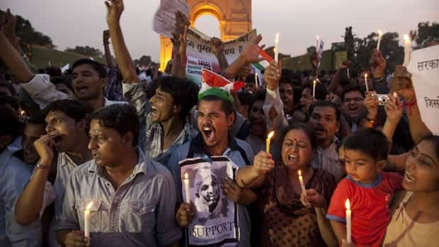 Supporters of India's most prominent anti-corruption crusader Anna Hazare gather in a show of support near the India Gate memorial in New Delhi on Wednesdsay.