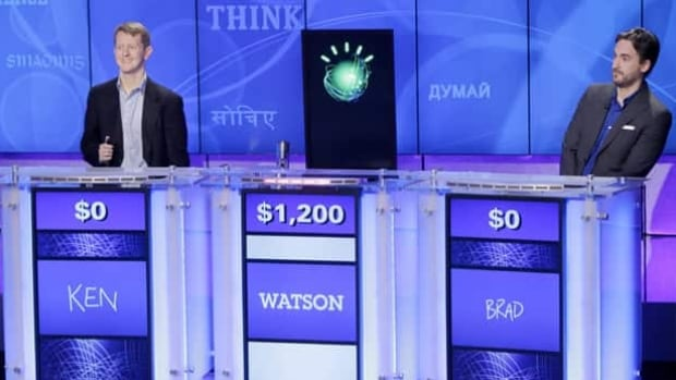 Jeopardy! champions Ken Jennings, left, and Brad Rutter, right, look on as the IBM computer called Watson beats them to the buzzer to answer a question during a practice round of the quiz show in Yorktown Heights, N.Y., in 2011.
