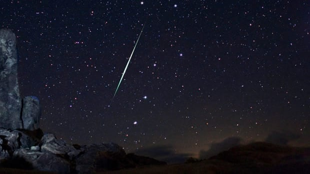 A Geminid fireball explodes over the Mojave Desert in California on Dec. 13, 2009. This year's show takes place Dec. 12 to 16 and peaks overnight Dec. 13 to 14.
