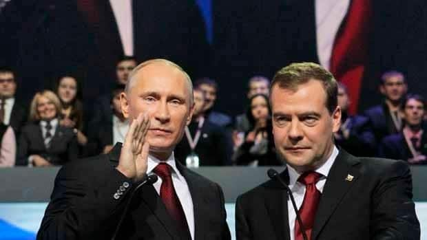 Prime Minister Vladimir Putin, left, and Russian President Dmitry Medvedev greet delegates during the United Russia party congress in Moscow on Sunday.