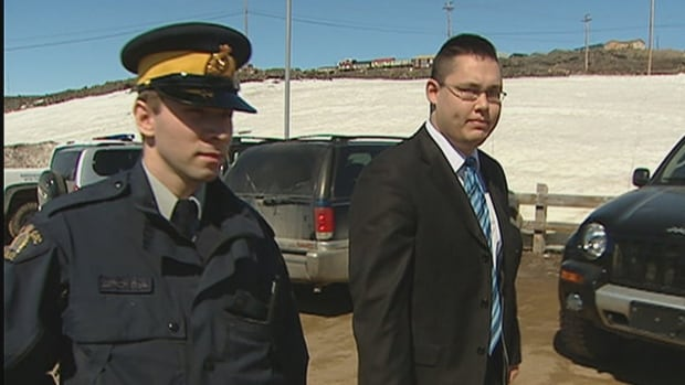 Christopher Bishop, right, is escorted into the Iqaluit courthouse on May 26, 2010 for his original trial. His new trial, with a judge alone, is set for Sept. 8, 2014.