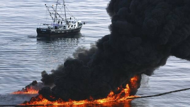 Smoke billows from a controlled burn of spilled oil off the Louisiana coast in the Gulf of Mexico coast line on June 13, 2010. Millions of gallons of oil poured into the Gulf after the April 20 explosion.