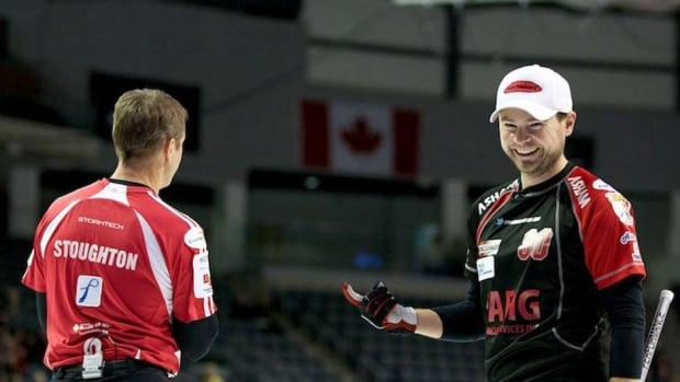 Mike McEwen, right, defeated Jeff Stoughton in Sunday's all-Manitoba final at the BDO Canadian Open in Kingston, Ont.