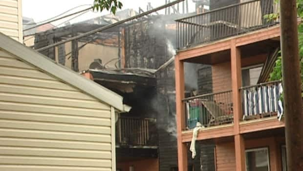 Fire damaged the roof of the 50-unit apartment building.