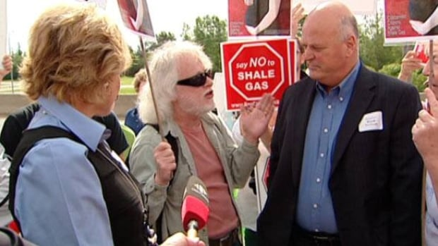 Environment Minister Margaret-Ann Blaney and Natural Resources Minister Bruce Northrup are confronted by people opposed to hydro-fracking in Fredericton.