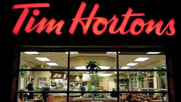 In a bid to compete with upmarket coffee chains, Tim Hortons will give some of its stores a makeover to attract a clientele that may prefer softer lighting and more comfortable chairs.