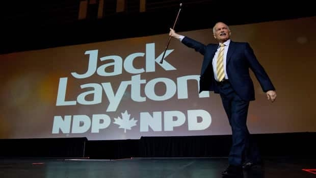 Jack Layton strides across the stage at the NDP's 50th anniversary convention in Vancounver on June 19.