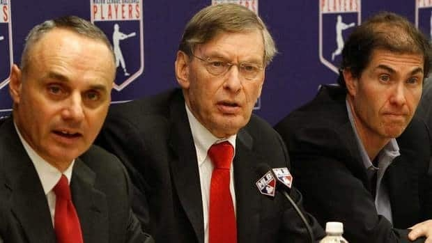 Major League Baseball commissioner Bud Selig, center, is flanked by Vice President of Labor Relations Rob Manfred, left, and MLB Players Association Executive Director Michael Weiner, during a new conference announcing a five-year collective bargaining agreement Tuesday in New York.