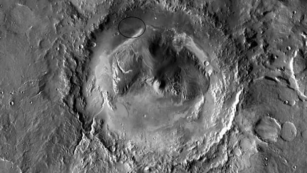 The landing site is at the base of a mountain that rises five kilometres high from the middle of the crater.