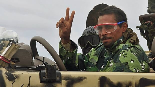 An anti-Gaddafi fighter gestures as he moves to the frontline at Ashreen Gate, east of Sirte.