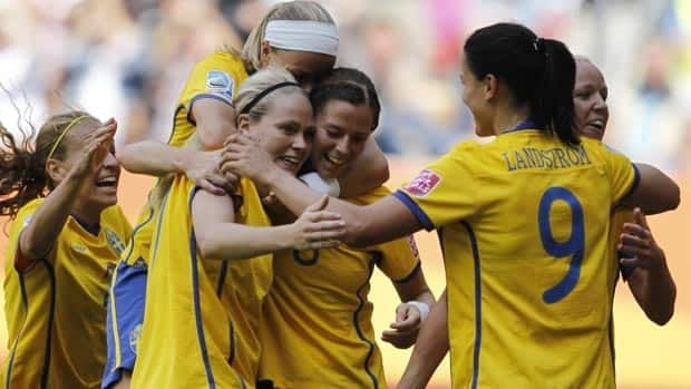 Lisa Dahlkvist, front left, leads Sweden in scoring with two goals at this tournament.