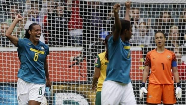Brazil's Rosana celebrates scoring on Australia goalkeeper Melissa Barbieri, right, in Moenchengladbach on Wednesday.