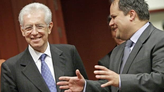 Italian Prime Minister and Finance Minister Mario Monti, left, speaks with Dutch Finance Minister Jan Kees De Jager as the 17 eurozone finance ministers met in Brussels Tuesday.