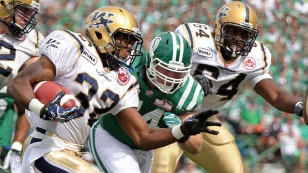 Winnipeg Blue Bombers running back Fred Reid runs the ball against the Saskatchewan Roughriders during the CFL first half action in Regina in 2010.