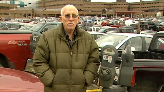 Cancer patient Tom Badcock is refusing to pay for parking while he receives treatments at the Health Sciences Centre.