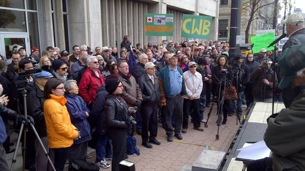 Supporters of the CWB rally in front of the board headquarters in downtown Winnipeg on Friday.