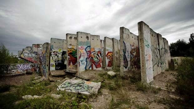 Original parts of the Berlin Wall stand on an area of a construction material company in Teltow, Berlin.