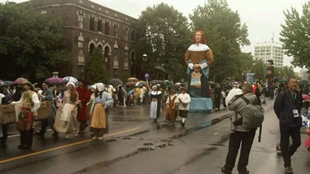 Thousands of people went out in the rain for the annual St-Jean-Baptiste parade in Montreal.