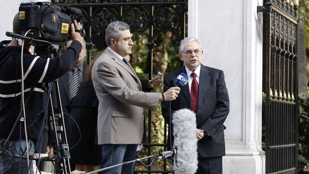 Incoming Prime Minister Lucas Papademos gives a statement after a meeting with Greek political leaders outside the Presidential palace in Athens on Thursday.