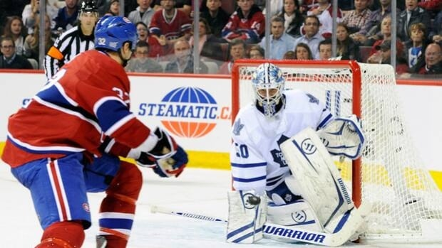 Maple Leafs goaltender Jonas Gustavsson, right, foils forward Travis Moen in a 5-4 overtime win at Montreal last Saturday.