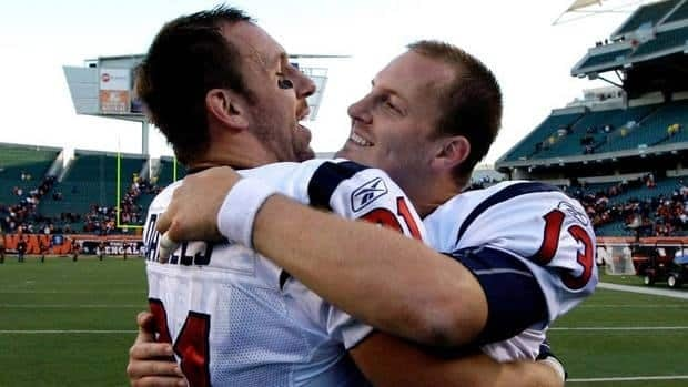 Texans quarterback T.J. Yates, right, celebrates his team's victory with teammate Owen Daniels Sunday in Cincinnati.