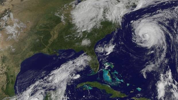 Tropical Storm Nate passes near the Yucatan Peninsula, while Hurricane Katia churns in the Atlantic Ocean and the remnants of Tropical Storm Lee linger over the northeastern U.S. on Thursday.