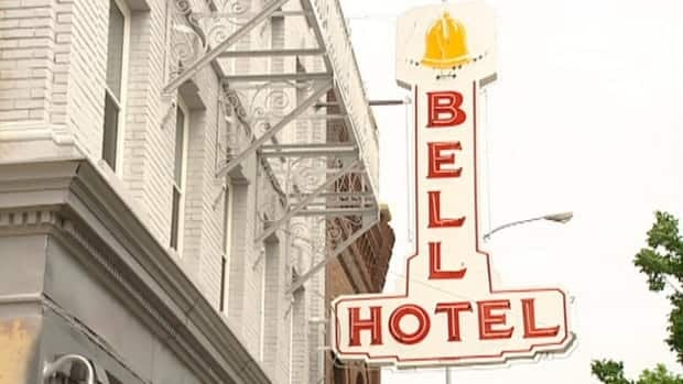 The Bell Hotel sign is back on, welcoming new tenants among Winnipeg's less fortunate.