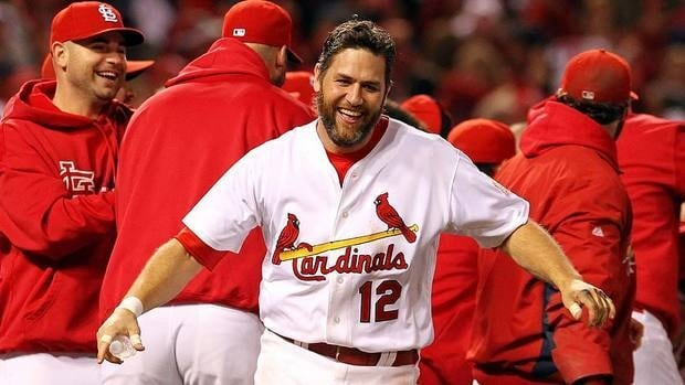 Cardinals' Lance Berkman, seen here celebrating the team's 11-inning, Game 6 win, made Tony La Russa look like a genius. After the manager moved Berkman up one spot in the batting order to fourth, the right-fielder went 3-for-5 with a homer, four runs scored and three RBIs.
