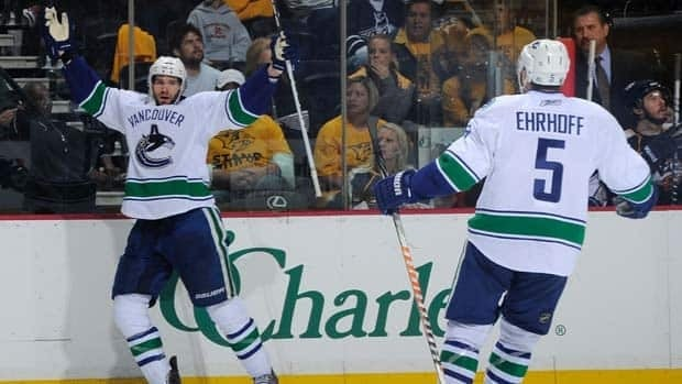 Canucks centre Ryan Kesler, left, celebrates his third-period goal with teammate Christian Ehrhoff Thursday night in Nashville, Tenn.