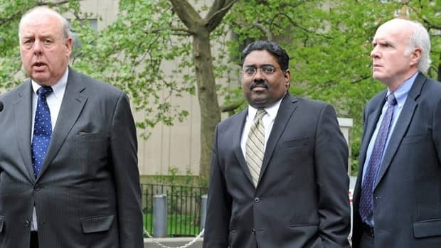 Billionaire co-founder of Galleon Group Raj Rajaratnam, center, exits Manhattan federal court with his attorneys John Dowd, left, and Terence Lynam, on Wednesday.