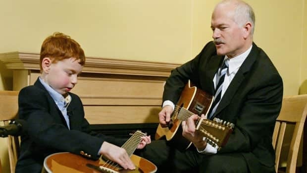 Jack Layton, the late NDP leader, plays guitar with children's show host Daniel Cook in 2006. Layton's last letter to Canadians has been turned into a song by Raffi.