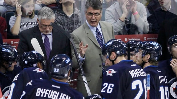 Winnipeg Jets' Winnipeg Jets head coach Claude Noel talks to his players during a time out in third period NHL action against the Dallas Stars in Winnipeg on Friday, October 11, 2013. THE CANADIAN PRESS/John Woods