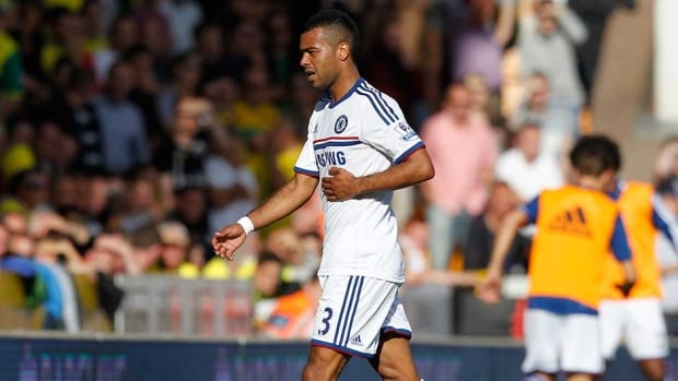 England defender Ashley Cole will miss his country's World Cup qualifier against Poland with a rib injury.