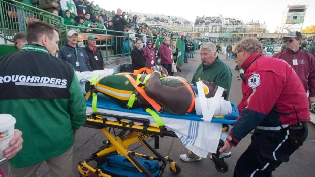Edmonton Eskimos training staff remove defensive tackle Almondo Sewell from the game after he was injured against the Saskatchewan Roughriders on Saturday.