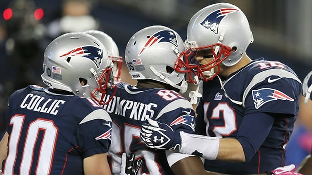 Tom Brady of the New England Patriots celebrates with wide receiver Kenbrell Thompkins after they connected for the game winning touchdown.