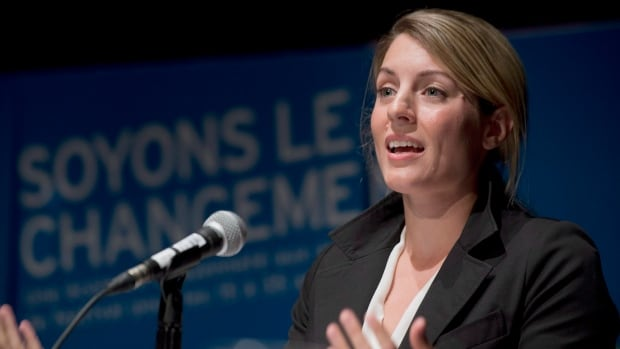 Montreal mayoralty candidate Melanie Joly speaks to supporters during the first debate in Montreal, Friday, August 16, 2013.