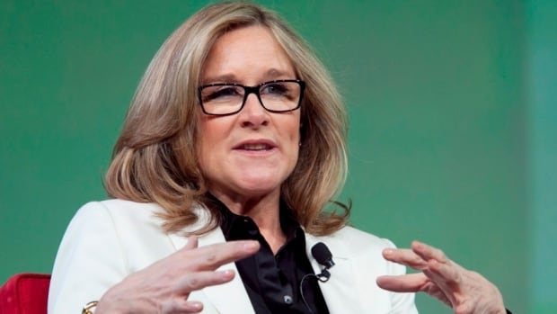 In this file photo, Burberry CEO Angela Ahrendts speaks at the National Retail Federation's annual convention in New York. Apple said Tuesday, Oct. 15, 2013, that Ahrendts will take charge of Apple's expansion plans and retail operation, as a senior vice president at the company next spring.