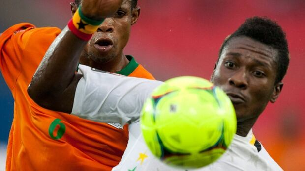 Ghana's Asamoah Gyan, right, scored twice Tuesday in a 6-1 drubbing of Egypt in the first leg of their World Cup playoff.