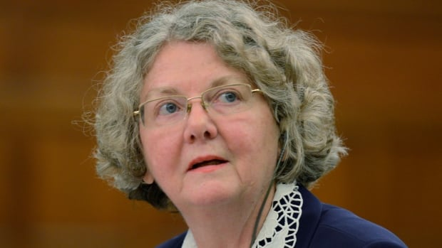 Ethics Commissioner Mary Dawson will serve for another six months after her term was renewed Friday.