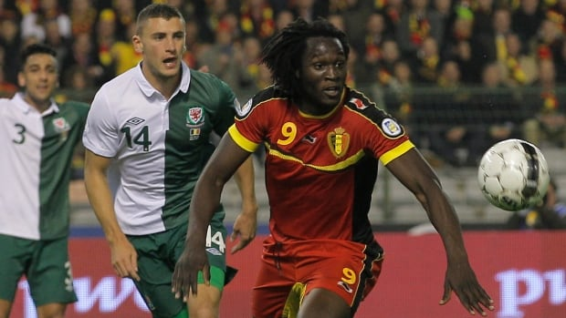 Belgium's Romelu Lukaku, right, is challenged by Wales' James Wilson during their World Cup Group A qualifying match at the King Baudouin stadium in Brussels on Tuesday.
