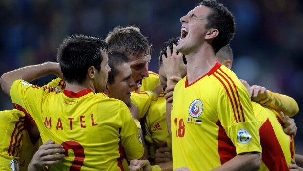 Romania's Florin Gardos, right, reacts after Ciprian Marica scored the second goal against Estonia during the World Cup Group D qualifying match at the National Arena stadium in Bucharest, Romania on Tuesday.