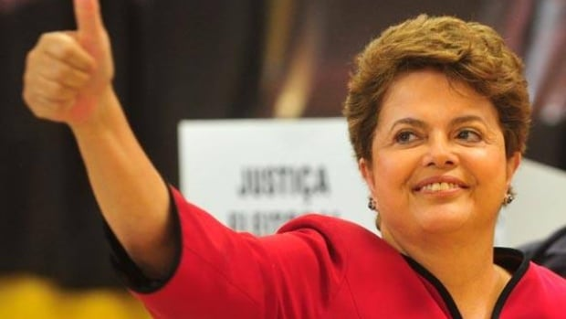 Dilma Rousseff, Brazil's presidential candidate from the ruling Workers' Party,  gestures as she leaves a voting booth in Porto Alegre, Oct. 31.
